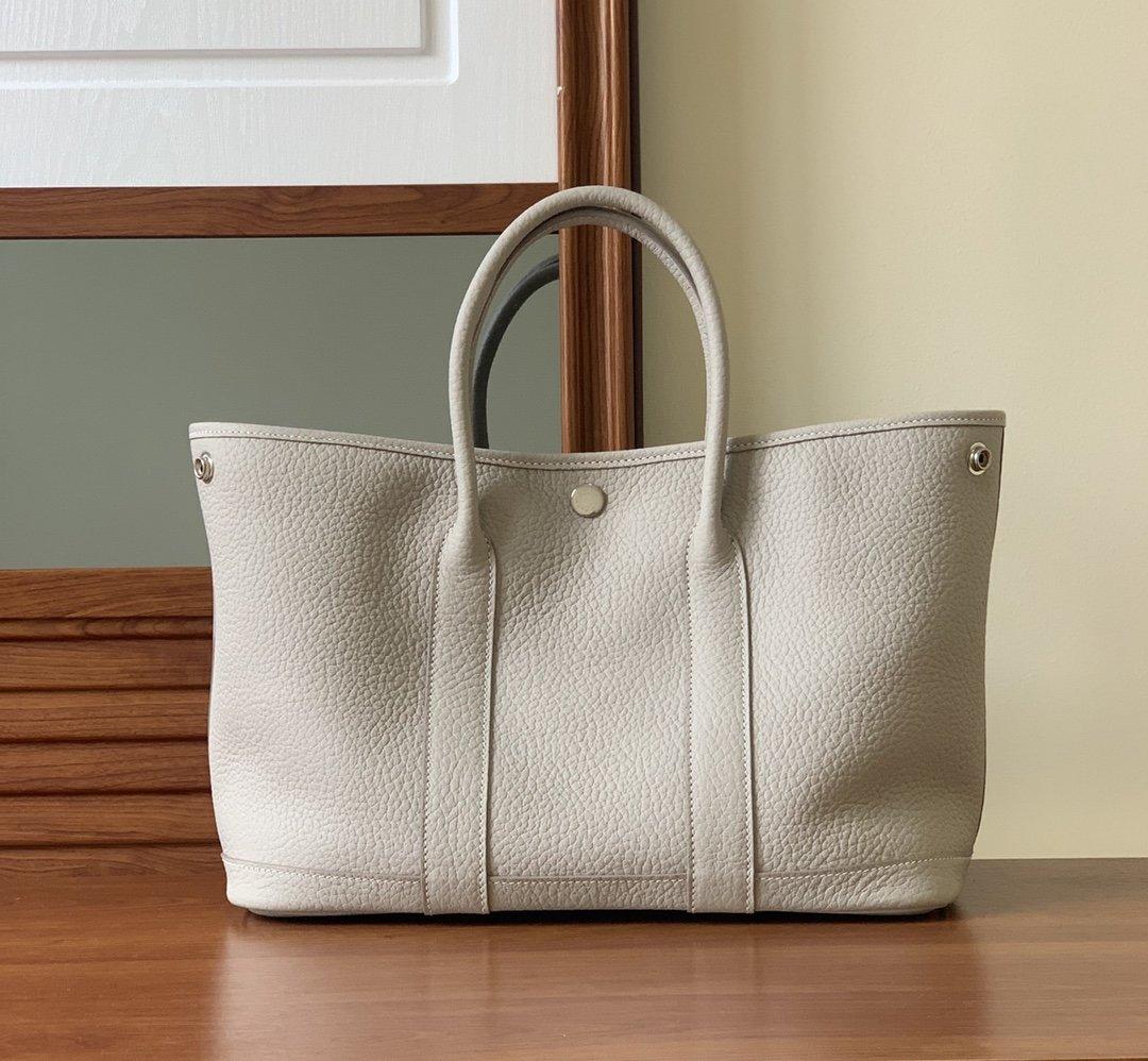 广州凯莉花园包厂家供应顶级手缝完美复刻原单包包一件代发